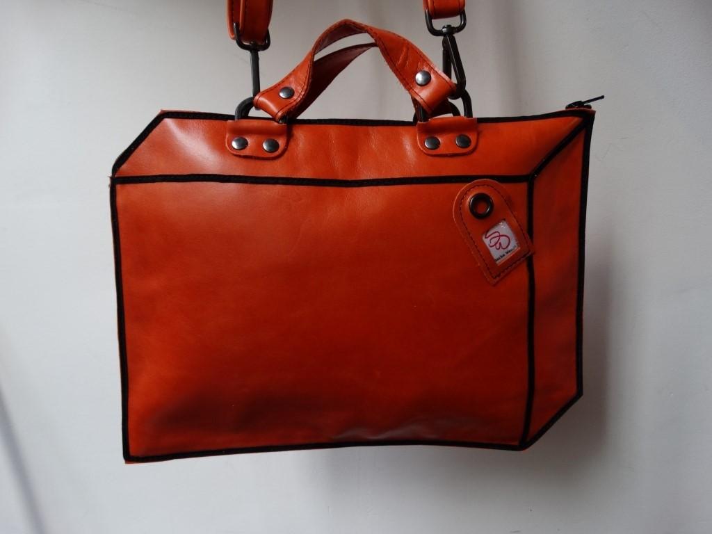 koffer oranje leer